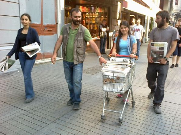 Left-wing groups are rushing to show their relevance by handing out free copies of their hard-to-read publications against capitalism and shopping malls - here delivered to the Taksim Square in a doubtless liberated supermarket trolley.