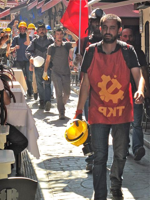 A tough column of protestors from the Turkish Communist Party moves through Nevizadeh restaurant street after a confrontation with police.