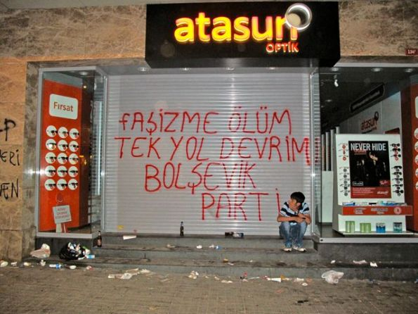 """Many left-wing slogans have appeared on the Istiklal St. shops - here 'Death to Fascism, the only way is Revolution. (Signed:) The Bolshevik Party"""""""