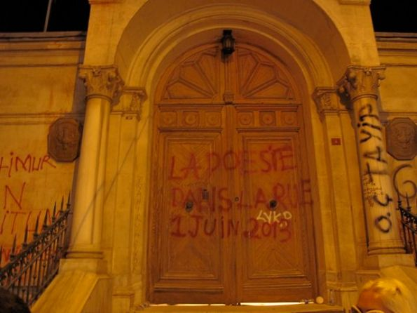 """The door of the French Consulate-General near Taksim. Here a slogan in French declares """"Poetry in the Street - 1 June 2013"""""""