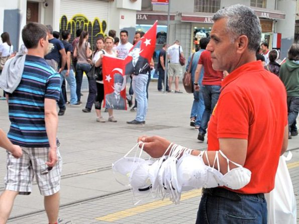 Turkey is a resilient country and people quickly sought to take advantage of any new opportunities - here a man finds a new market in surgical masks protestors use to protect themselves from tear gas.