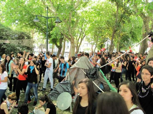University students moving off to man the barricades after meeting, singing and dancing under the trees of Gezi Park.
