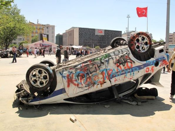 An overturned police car on Taksim Square. However, I don't think more than a dozen vehicles were damaged in the first days at least.