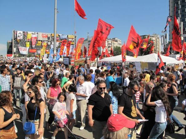 A line of stands in Taksim Square in front of the old Ataturk Culture Centre, now a corkboard of revolutionary slogans