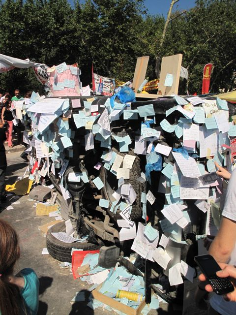 A pick-up truck overturned in the first night of protests has become a wish-list of protestors' demands - typically, an end to the concrete covers up 98.5 per cent of the city.