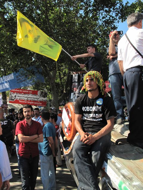 The Kurdish nationalist movement has carved out its own corner of the square, where flags showing the jailed leader of the Kurdistan Workers' Party (PKK) are waved as here from an overturned police car.