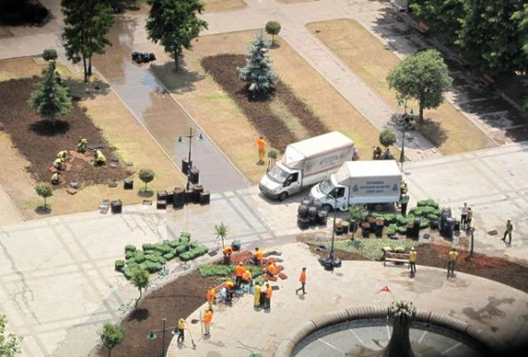 Fixing the Gezi Park flowerbeds, the morning after the Taksim Commune was ejected.