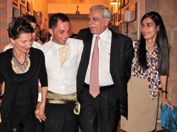Much-jailed Turkish Kurd leader Ahmet Türk (second from right) dances at a party two months after his March 2011 election as the municipal mayor of a major Kurdish-majority province in Turkey. On the right is his co-chair, Syriac Orthodox Christian xx xx, an articulate new Mardin municipal council member.